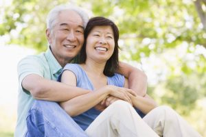 retired couple relaxing outdoors smiling scaled 1