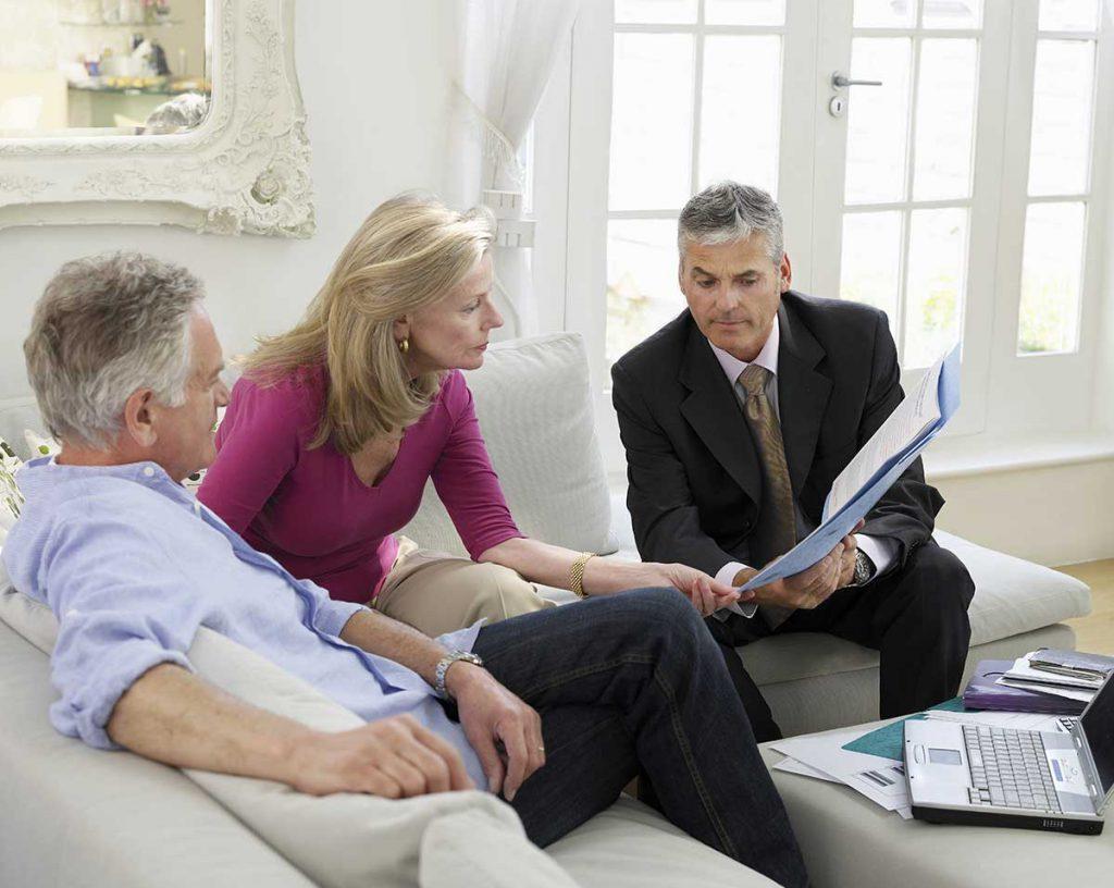 Financial Advisor explaining retirement plan to Baby Boomer couple